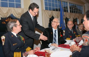 Gov. Malloy congratulates William Schietinger (with Gerald Schaffer, left & george Thompson, right)